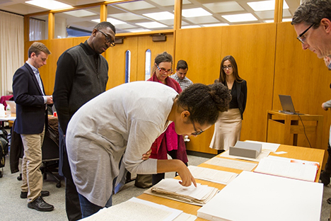 Playwrights Jackie Sibbles Drury (foreground), Kwame Kwei-Armah (center left), and Emily Mann (center) review historical sources. Photo Credit: Matt Pilsner