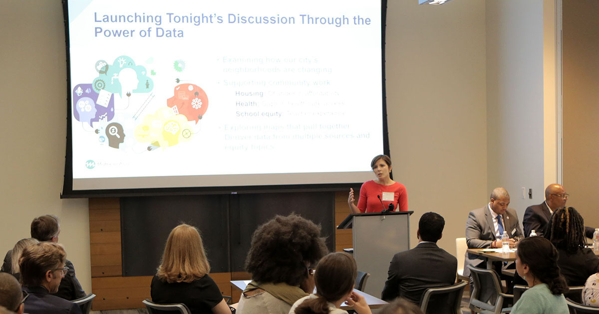 Marykate Zukiewicz, Mathematica researcher and Denver resident, presenting a data visualization on housing, education, and health trends in the Denver metro region. Photo by Rich Clement.