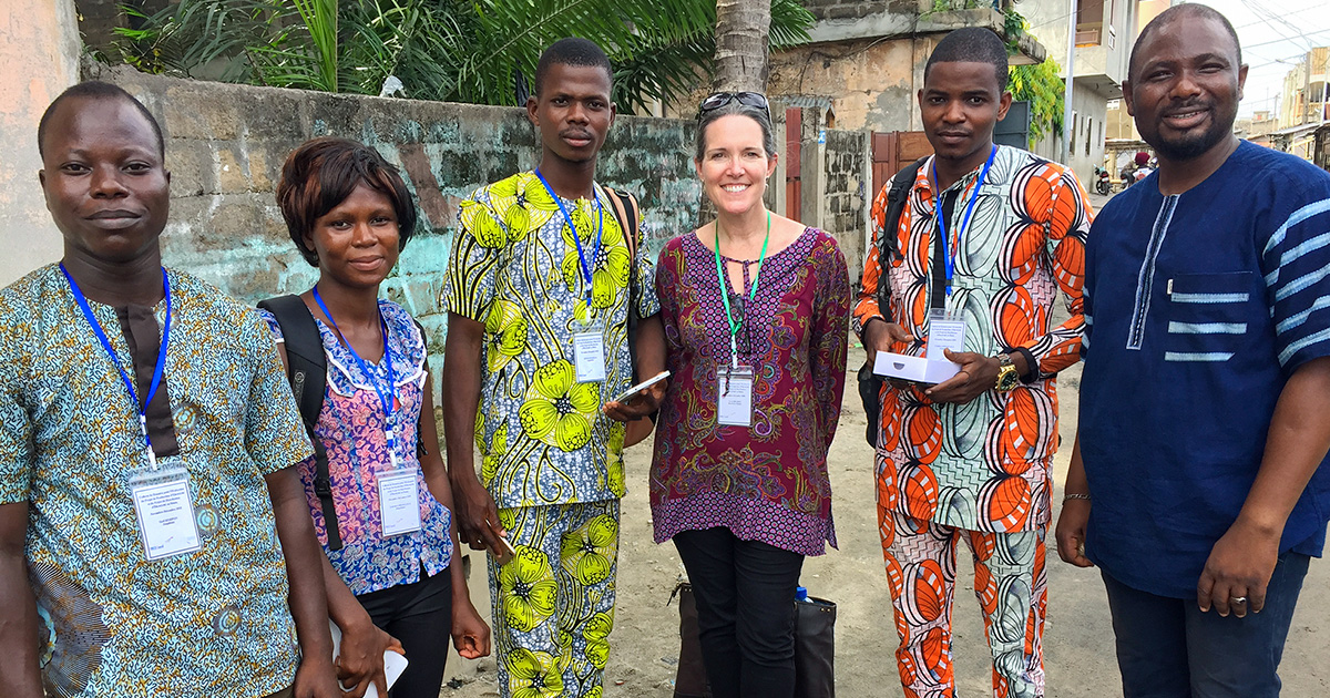 Sarah, (pictured third to the left), works with researchers in Benin to help the Benin government and the Millennium Challenge Corporation understand the impact of improved electricity on businesses and households.
