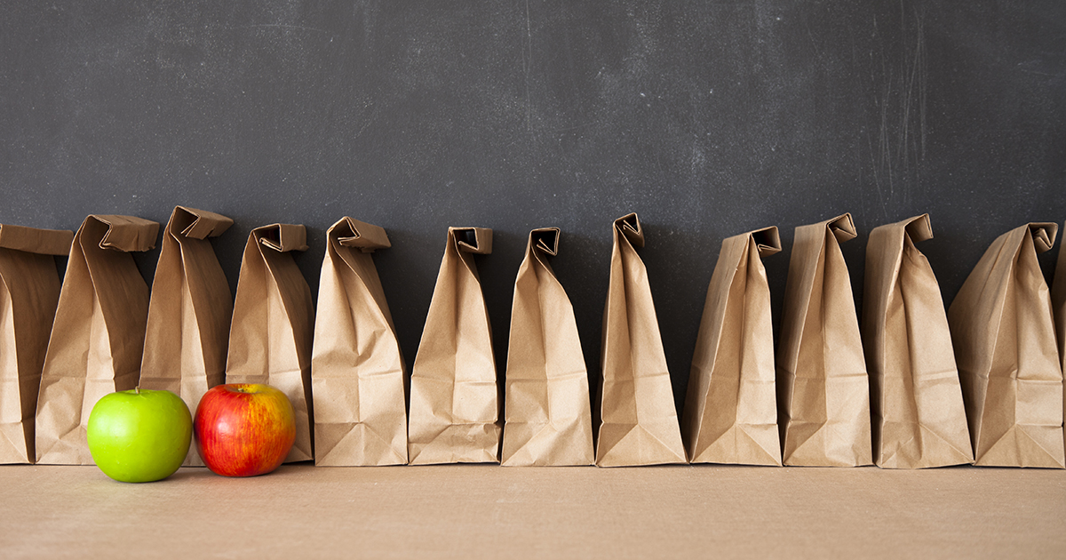 Brown bags in front of blackboard