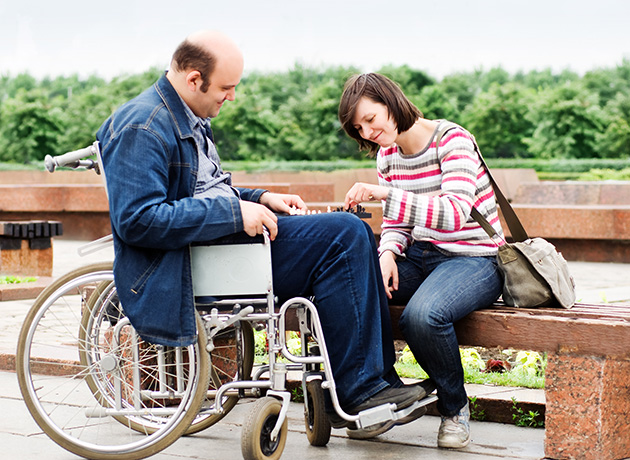 man in wheelchair with female friend