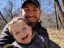 Scott Baumgartner enjoys time with his 2-year old son.