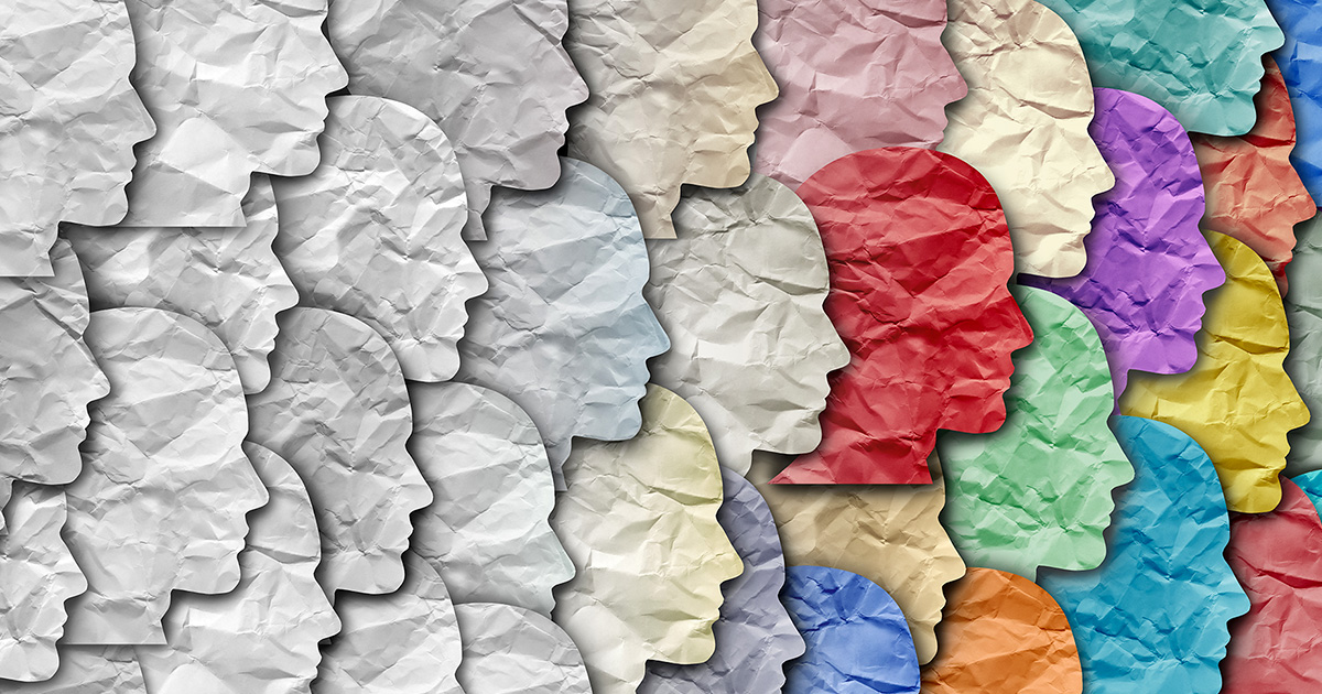 Right-facing profiles of faces cut from crinkled paper, overlaying each other, fading from white on the left to many different colors on the right.
