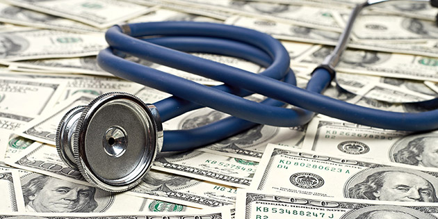 Stethoscope on top of money