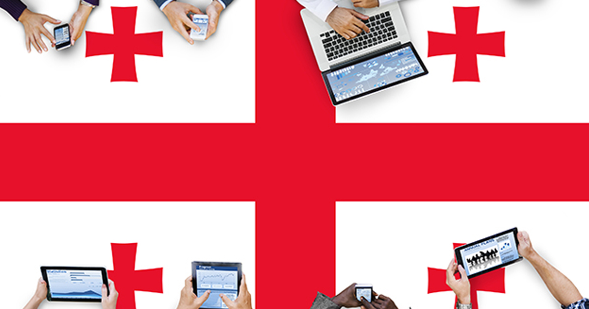 Georgia flag with people using computers