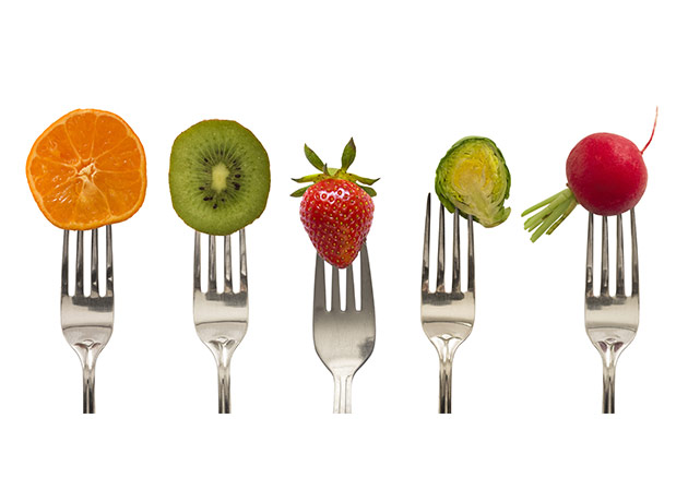 fruits and vegs on a fork
