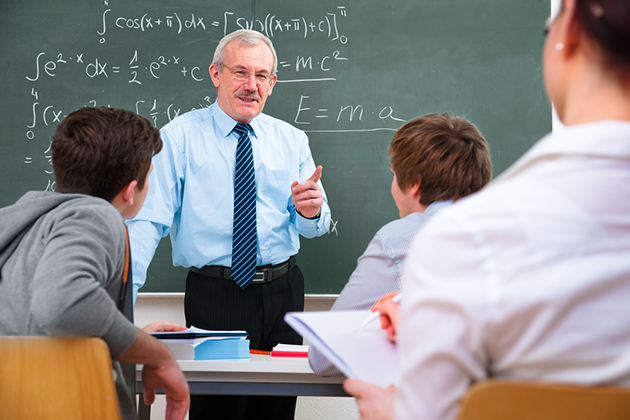 High school math teacher in classroom with students